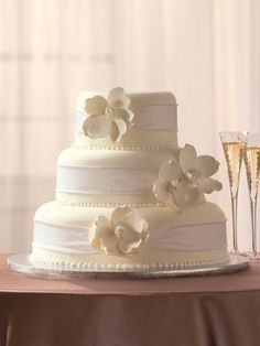 Magnolia Moments-My Wedding cake...I'm going to have Publix use burlap instead of white ribbon!
