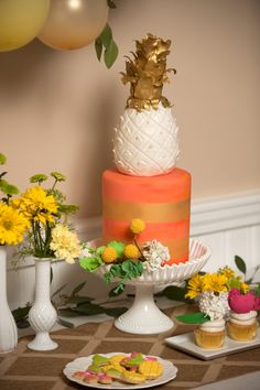 DIY Wedding Design ideas to create your own Pineapple Themed Bridal Shower - LOVE this orange and gold wedding cake topped with a white and gold pineapple