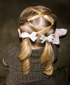 lattice ponytails. I think this would be cute on the little girls at my church
