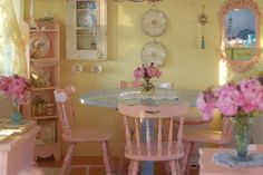 I have a chair like these that I painted fuchsia with butterflies and gold accents. Pretty!