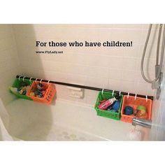 Shower curtain rod & rings w plastic crates to hold bath toys for kids