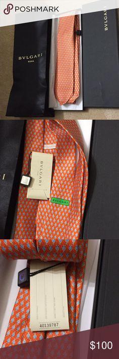 BVLGARI NWT men's tie NWT men's tie that is orange with light blue penguins on the tie. BVLGARI Accessories Ties