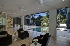 Electric screens descend from the ceiling to make this lanai insect free
