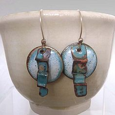 Dripping Blue by Evelyn Markasky. 2-piece Copper Enamel Earrings. Crackled enameled round domed piece topped with a fold-formed strip of turquoise enamel. Measures about an inch and a half from top to bottom. Price: $45.00  On Artful Vision, a portion of your purchase is donated to a participating non-profit of your choice.