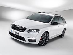 The ŠKODA Octavia RS wagon. My car of choice right now. Practical, sporty, and looks greta in white and black with a flash of red - perfect combination. Vw Group, Wagon Cars, Black Edition, Car Accessories, Cars And Motorcycles, Sporty, Bike, November 2013, F1
