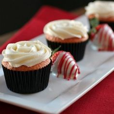 These strawberry cupcakes are moist and delicious and topped with a white chocolate buttercream.  Nothing says I love you more!