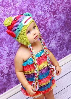 Rainbow sock monkey hat! Someone's kid needs a hat....or maybe @Cathy Ma Ma Papa does lol
