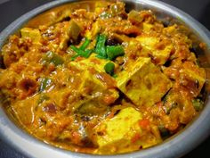 A famous Indian Curry made by cooking paneer in a rich and creamy onion capsicum tomato gravy.