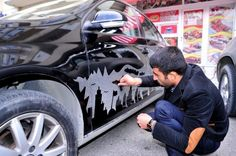 Parking Attendant Turns Dusty Cars Into Works of Art