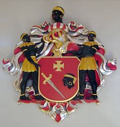 This beautiful piece of art is the coat of arms of a merchant's guild in the Baltic States of northeastern Europe. It was called the Brotherhood of the Blackheads. Their patron was Saint Maurice--a Black saint in medieval and renaissance Europe.