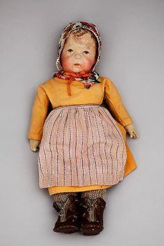 """17"""" Type I traditional ethnic girl doll, with leather boots (featuring real zipper), Germany, 1915-19, by Käthe Kruse."""