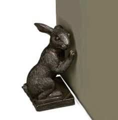 Hold your doors with our cast iron rabbit door stop shown here in a beautiful antique finish.
