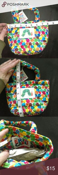 Eric Carle small quilted bag New with tags and Eric Carle small quilted bag. Made by quilted Kola. Bundle and save. No reasonable offer refused. Eric Carle Quilted Kola Accessories Bags