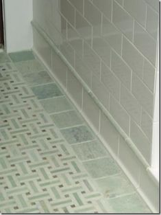 Love the trim on the wall close to the floor and the square tiles used as trim on the floor.  Also the basketweave floor pattern