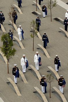 WASHINGTON (Sept. 11, 2008) One hundred eighty-four joint service troops stand unveil the Pentagon Memorial in Washington. The national memorial is the first to be dedicated to those killed at the Pentagon Sept. 11, 2001. The site contains 184 inscribed memorial units honoring the 59 people aboard American Airlines Flight 77 and the 125 in the building who lost their lives that day. U.S. Navy photo by Mass Communication Specialist 2nd Class Molly A. Burgess