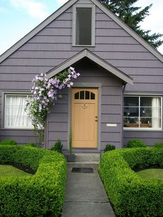 Leah Steen's Love the dusky mauve grey outdoor paint colour against the lush green