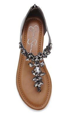 Gunmetal T-strap leather sandals bejeweled with eye-catching crystals and an easy back zipper.