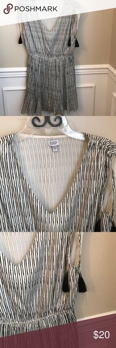 Charming Charlie Striped Pleated Dress Sleeves are sleeveless and cinch. Color is cream and black. Excellent condition. Reasonable offers accepted via offer button only. No trades. I strive to maintain good feedback. I'm a real person. If for any reason you are unhappy with your purchase, please contact me. Charming Charlie Dresses Mini