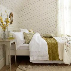 Small dainty florals repeated like polka dots on wallpaper and fabric are a subtle way to add pattern to a bedroom. Team with white painted cottage-style furniture and printed voiles.