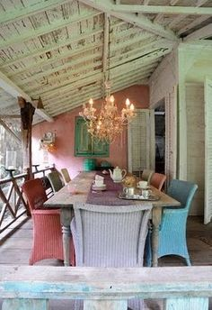 great porch dining room, love the shabby mix of color!