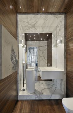 Marvelous use of materials in this bath, marble, wood, mirror, polished wood drawer and nickel |  Yorkville Penthouse by Cecconi Simone