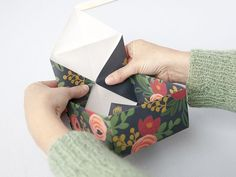 Turn a pretty sheet of paper into a gift box with this how-to. #giftboxes