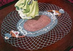 Lady Fair doily crochet pattern from Crinoline Lady in Crochet, originally published by Coats & Clark, Book No. 262, in 1949.
