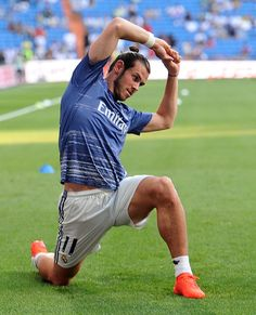 Gareth Bale of Real Madrid stretches during warmup for the La Liga match between Real Madrid CF and RC Celta de Vigo at Estadio Santiago Bernabeu on...