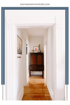 A beautiful hallway design with wood floors and white trim is part of this total home renovation, which highlights this globe touring couples many adventures. Highlights include this eclectic entryway filled with elements from their international travels. Designed by East and Gray Interiors, a full service interior design studio. Also providing virtual interior design service, space planning, and virtual consultations. Interior Design Studio, Interior Design Services, Victorian Village, Modern Hallway, White Trim, Hallways, Home Renovation, Touring, Floors