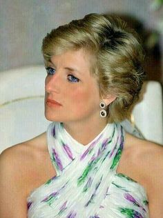 Princess Diana. She looks sad in this picture.