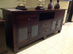 Keep your dining room organized with a beautiful solid wood sideboard. | Houston, TX | Gallery Furniture |