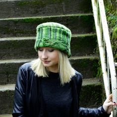 A unique fiber art hat, A stylish cloche for this winter,Afreda is made from shades of green Merino wool.I have used the nuno-felting technique (felt and fabric). Nunofelt It is Made with pure merino wool, and cotton fabric. Merino wool fibers are spread thinly upon a cotton fabric. The result is a light, soft and warm Hat. ♦This Hat has a super leaf on the side of the hat. ♦Felt is so versatile, by heating the felt up you can make it bigger by stretching the wool. To make it smaller you…