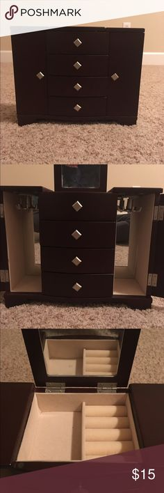 Small Jewelry Box Brown smooth wood jewelry box, brand new. Has three drawers, two necklace holders, and a ring holder on top with mirror. Other