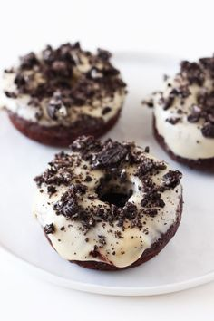 Cookies and Cream Chocolate Doughnuts have a baked chocolate fudge doughnut, an ultra thick sweet icing, and a generous sprinkling of crushed Oreos.