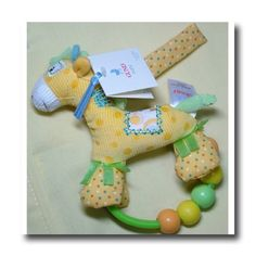 "GUND Baby - Hopscotch Beaded Rattle Giraffe by Gund. $9.31. This adorable yellow corduroy giraffe can attach to a stroller, carrier or crib with a velcro close. Features a beaded rattle.  Measures 5.5"".  Surface washable.. Save 22% Off!"