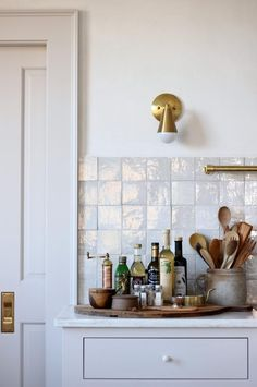 Kitchen with glazed tile backsplash in Maine house designed by Jersey Ice Cream Co.