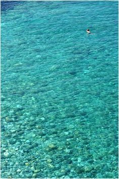 Swimming in Mylopotamos beach, Magnesia prefecture (Pelion mountain)