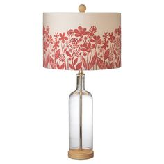 Featuring a clear glass base highlighted by a wildflower-print shade, this charming table lamp brims with country-chic appeal.   Pr...