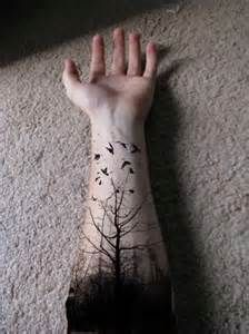 I love the creepy feeling of this tattoo, but at the bottom where it is all black, I wouldn't want that solid black. I also love the birds and I'm thinking of adding black sparrows flying from the three.