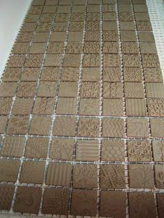 Gary Jackson.  Idee : tegeltjes laten drogen op een soort rooster Handmade tiles can be colour coordinated and customized re. shape, texture, pattern, etc. by ceramic design studios
