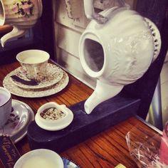 Teapot bird house...birds need pretty homes to
