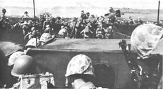 ASSAULT TROOPS of the 4th Marine Division go ashore on Iwo Jima. (USMC 110109