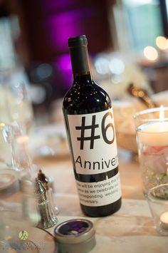 Wine bottle table numbers to be enjoyed by the couple on each anniversary they share | Lasting Images Photography| villasiena.cc