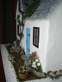 This is the outside of my little shabby cottage - with the garden done!!! I have never made a garden before, so I was really grateful to my...