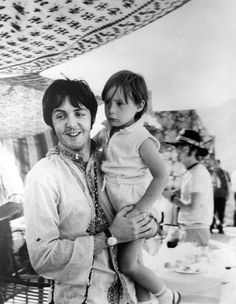 Paul McCartney holds four year old Julian Lennon, during a holiday near Athens in Greece, 1967.