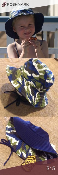 """Green/Navy Camo Reversible Sun Hat This adorable Camo sun hat is reversible with green, navy and white Camo on one side, and solid navy on the other. Optional neck ties. Water friendly and super comfortable. Nylon/elastane blend. Available in S/M(fits head circumference up to 17""""), and M/L ( fits head circumference up to 18"""") 2Chillies Accessories Hats"""