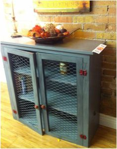 Old Cabinet Upcycle. Gray with Contrasting Red Hardware & chicken wire. cute