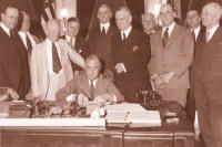 On June 16, 1933, President Franklin Roosevelt signed THE BANKING ACT OF 1933, a part of which established the FDIC.  ~  At Roosevelt's immediate right and left were Sen. Carter Glass of Virginia and Rep. Henry Steagall of Alabama, the two most prominent figures in the bill's development.