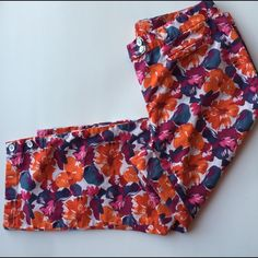 LOFT tropical vacation capri crops 10p Warm colors saturate these fun capris.  Instantly energizes your day and gives off a happy & confident vibe to all you meet!  Size 10p by Ann Taylor Loft.  Cropped pants/ capris. Colors: fuschia pink, tangerine Orange, bright navy blue, white.   Has white button details at the bottom of the legs to create more looks- expand for a wider leg or keep buttoned for a more tailored look LOFT Pants Ankle & Cropped