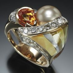 It's like the pearl and the gem are being cradled together. Randy Polk is a master!!